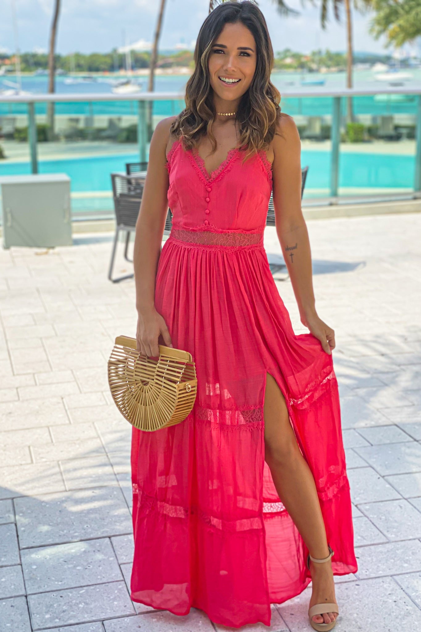 coral maxi dress with lace trim and slit
