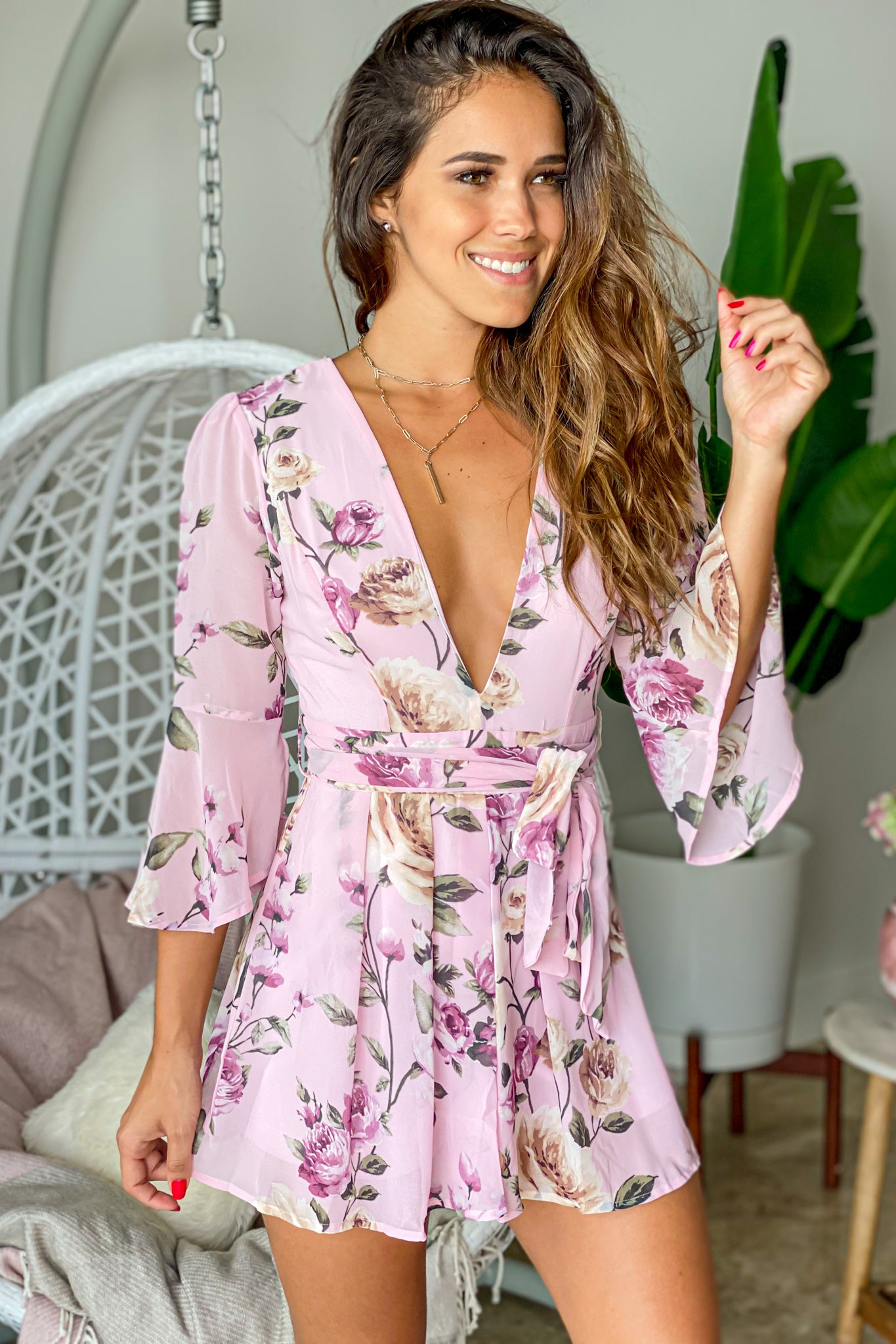 dusty pink floral romper with sleeves