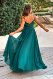 emerald maxi dress with embroidered back and button detail