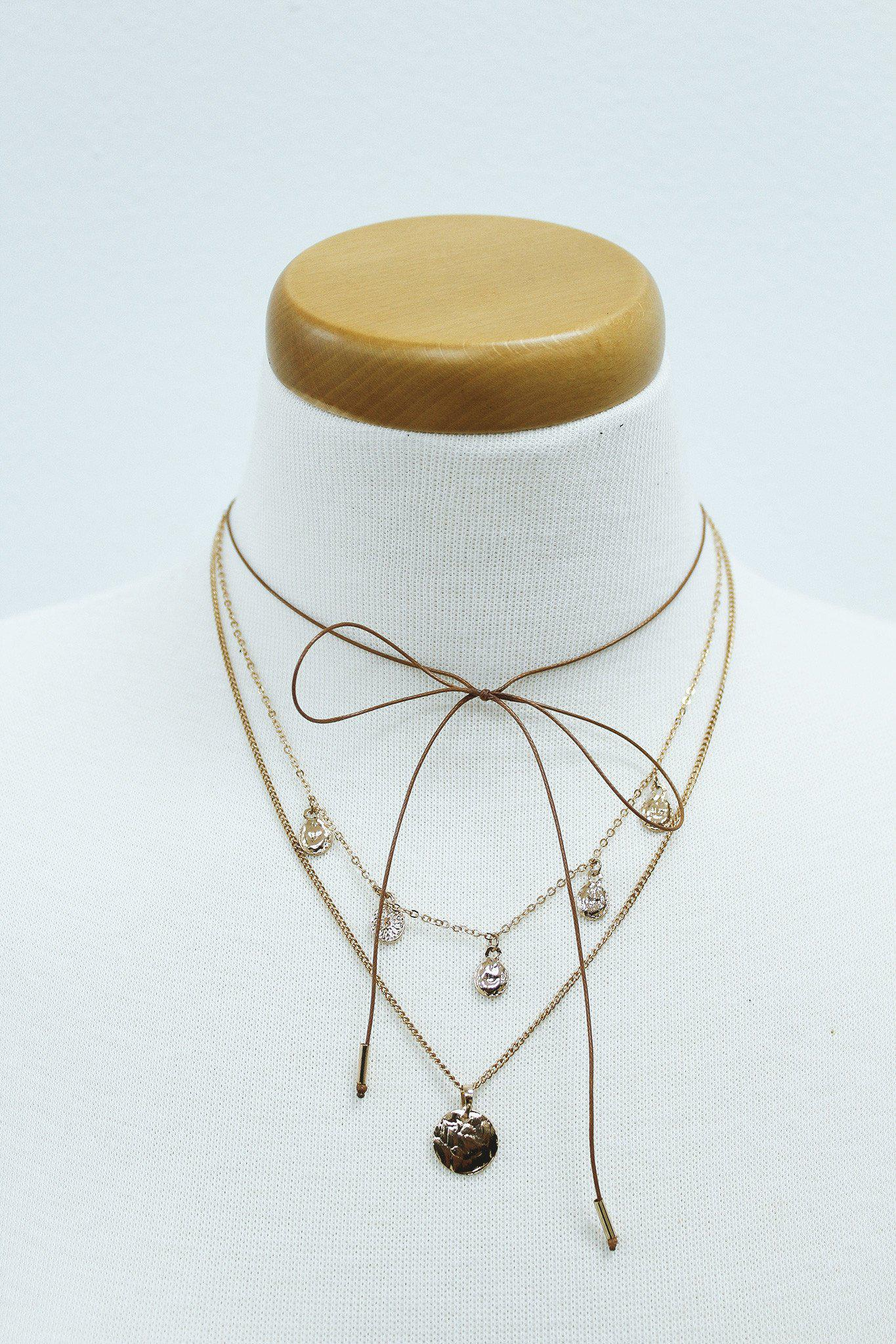gold and brown tie layered necklace