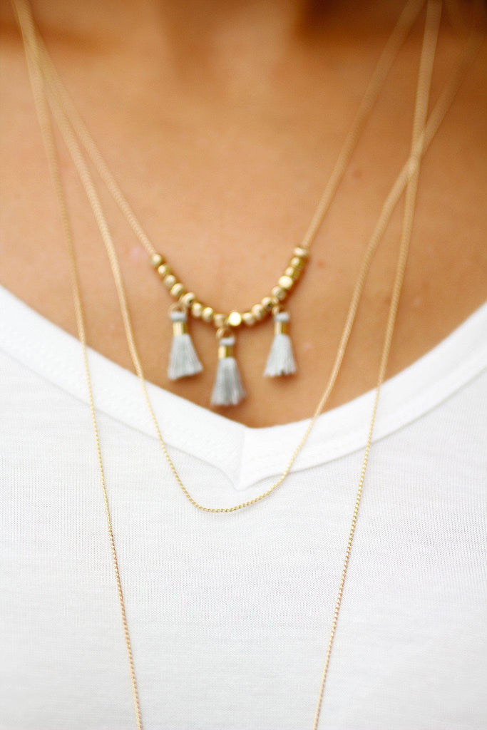 Gold Layered Gray Tassel Necklace