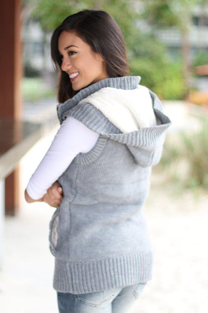 gray hooded vest