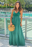 hunter green maxi dress with open back and frayed hem