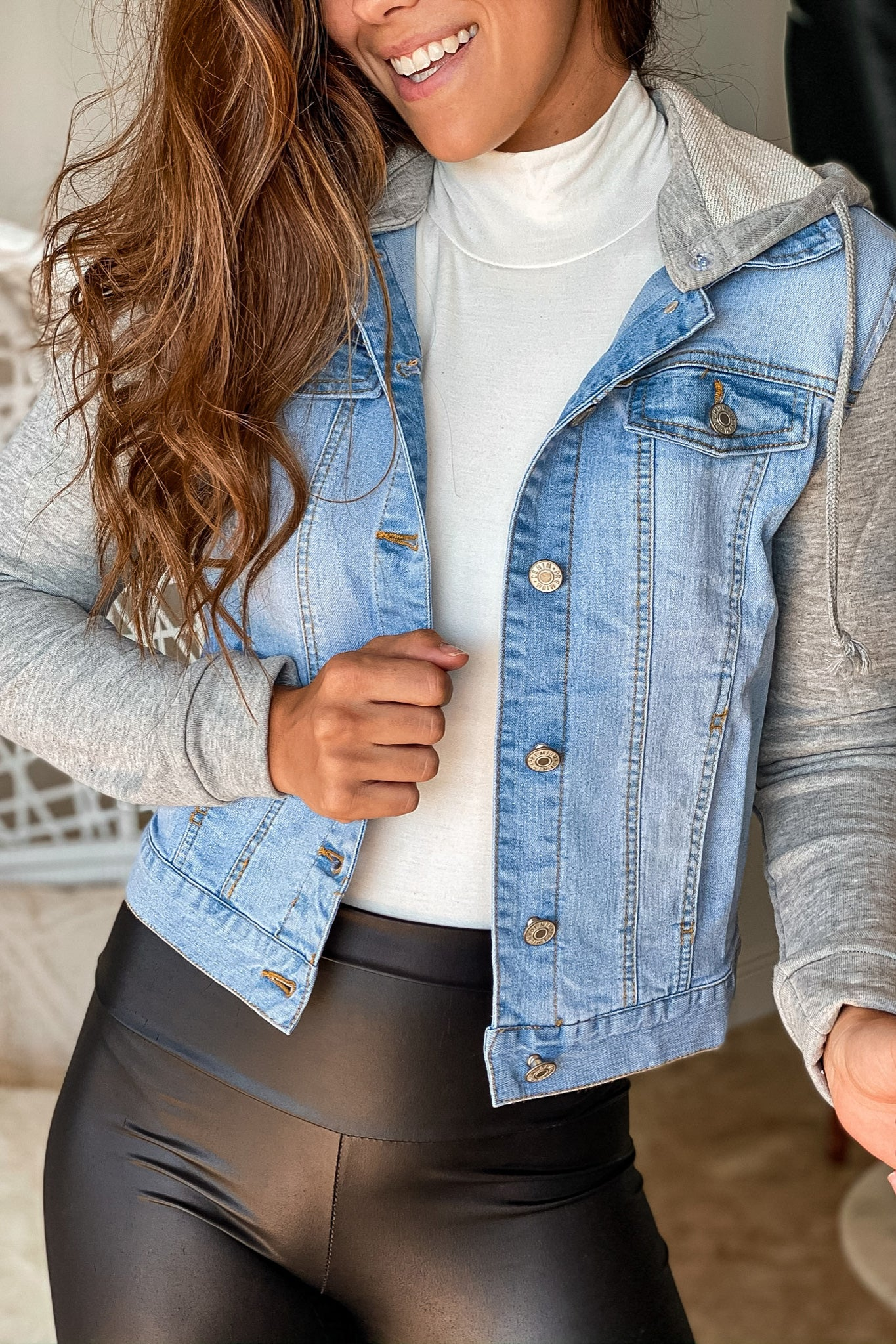 light blue jean jacket with gray hood