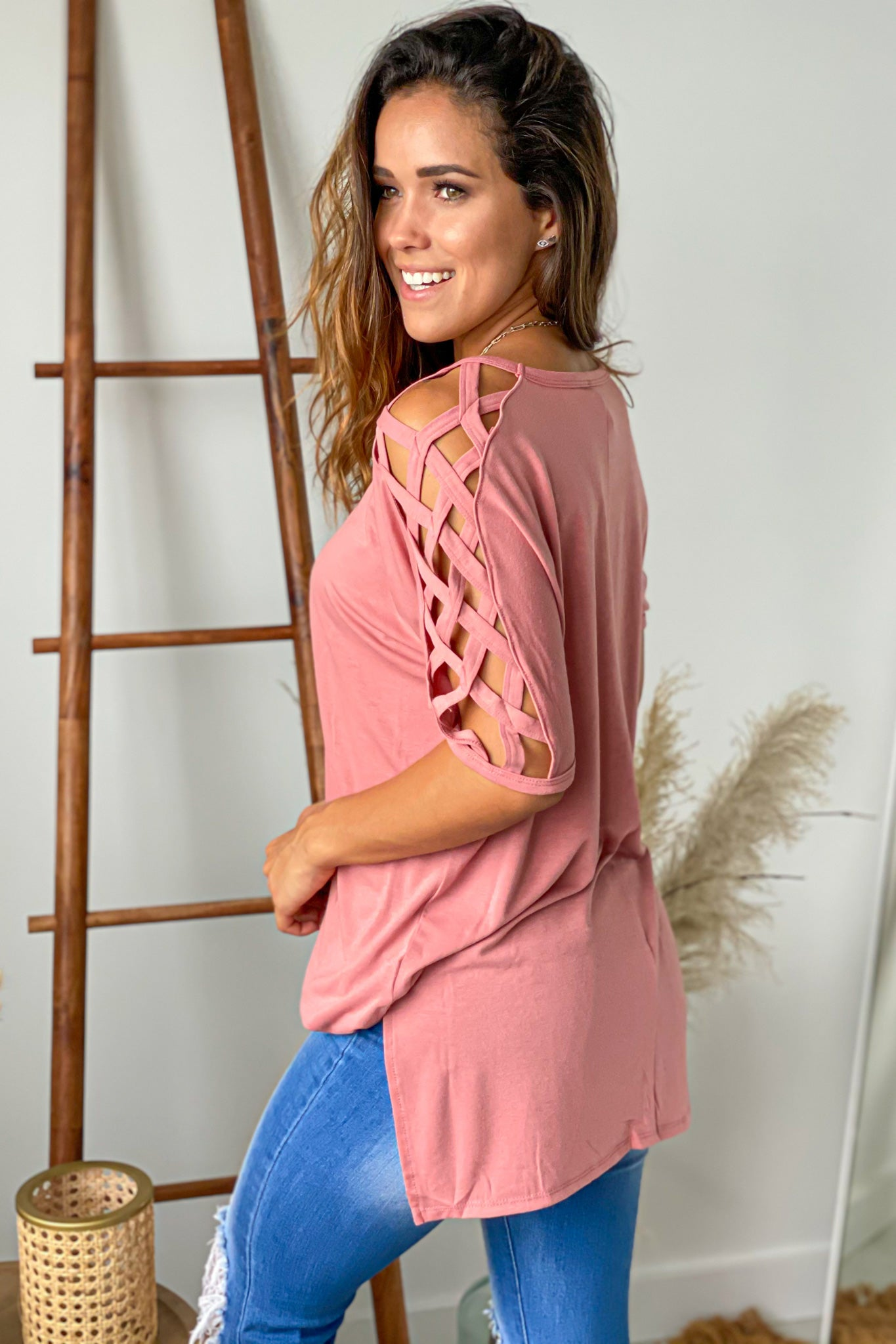 mauve top with strappy sleeves