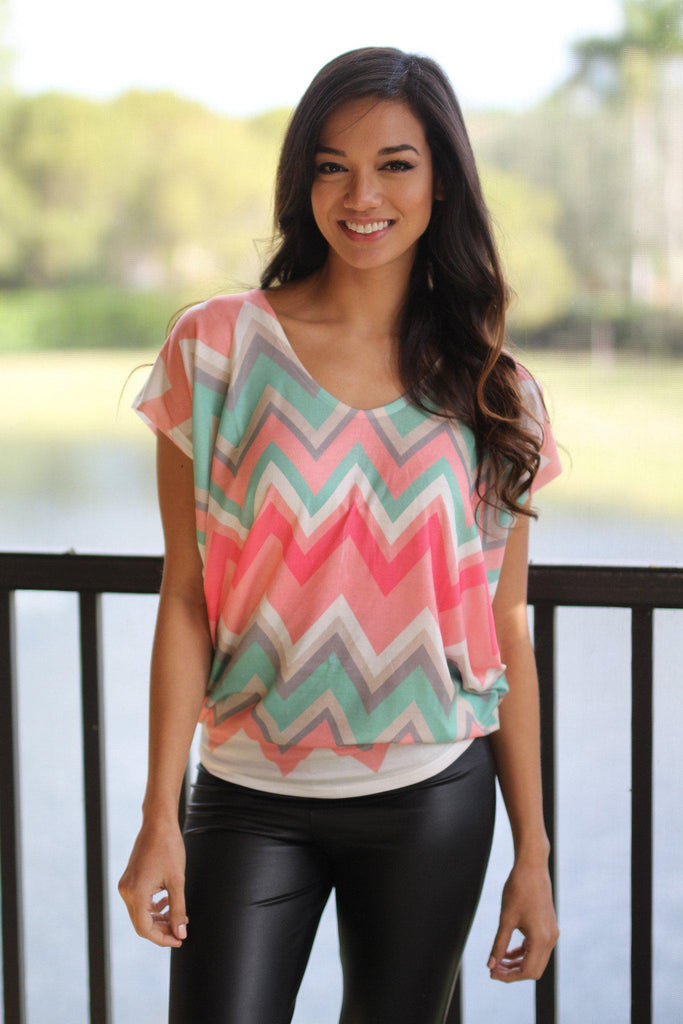 coral and mint printed top