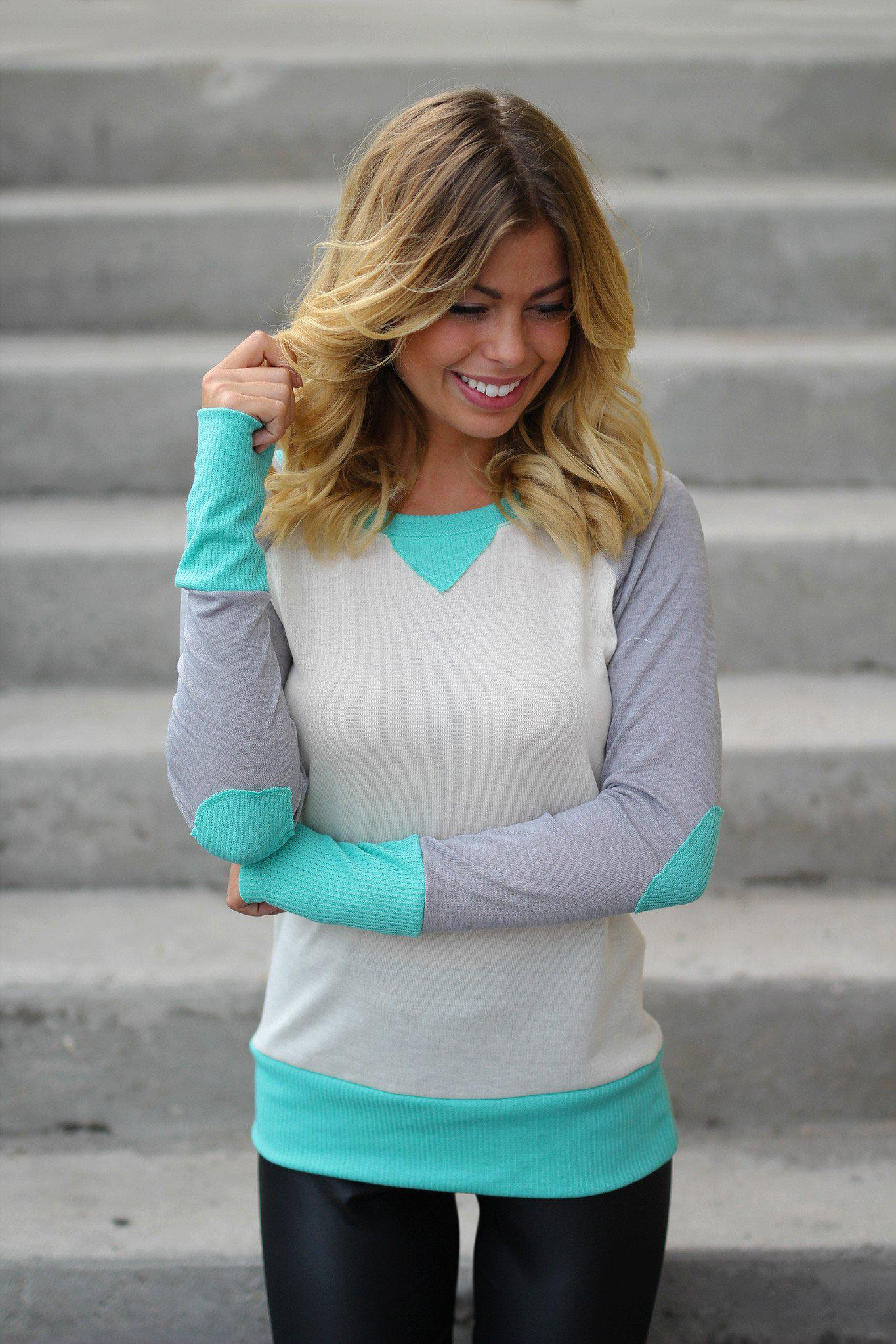 mint cream top with elbow patches