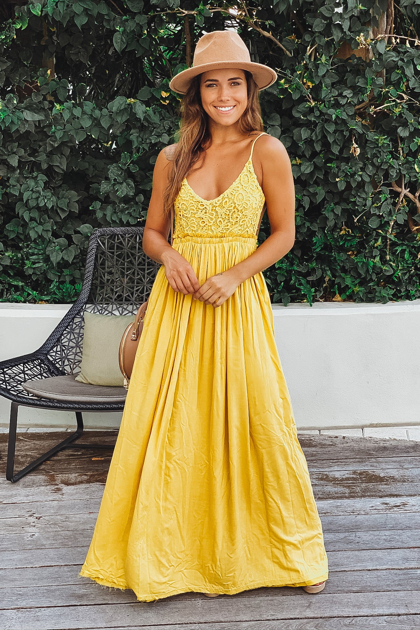 mustard maxi dress with open back and frayed hem