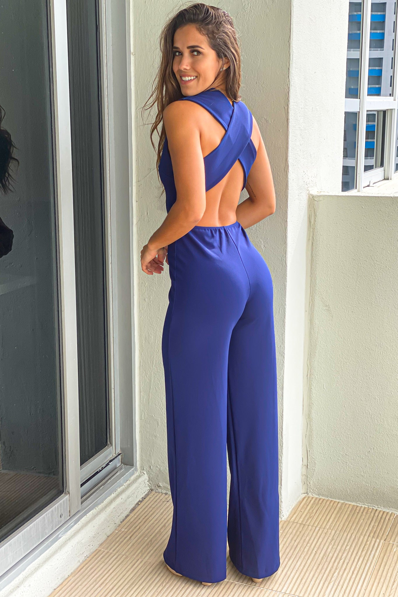 navy v-neck jumpsuit with criss cross back