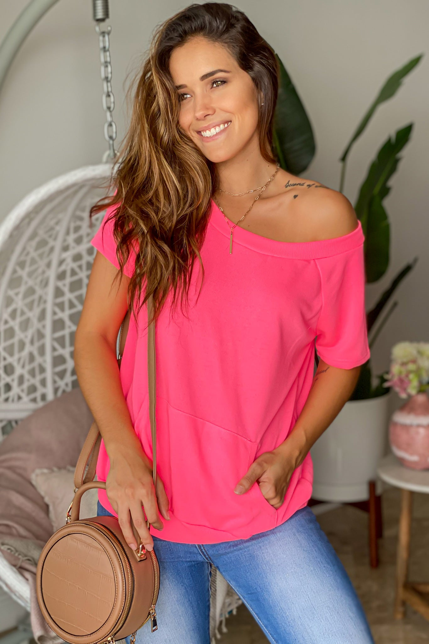 neon pink off shoulder top with front pocket