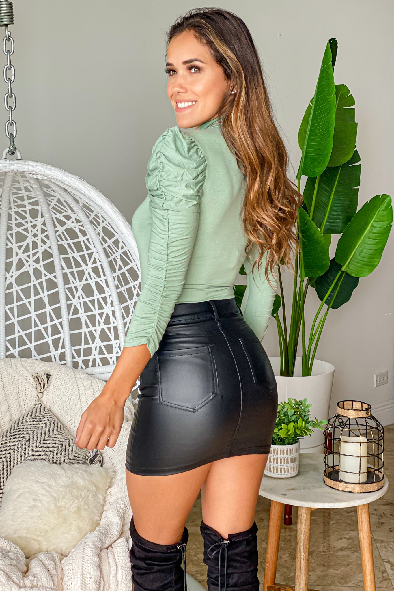 sage bodysuit with ruched sleeves