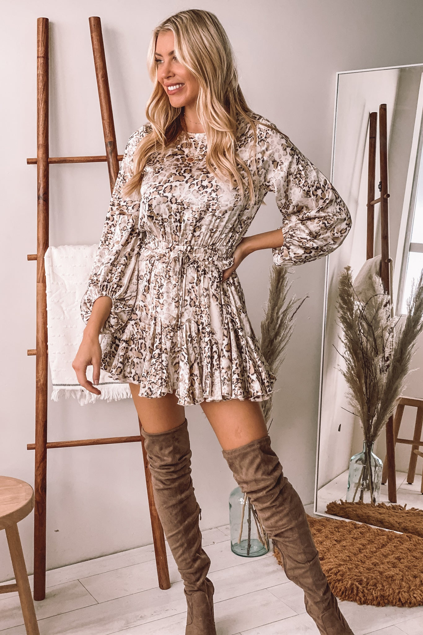 snake print romper with long sleeves