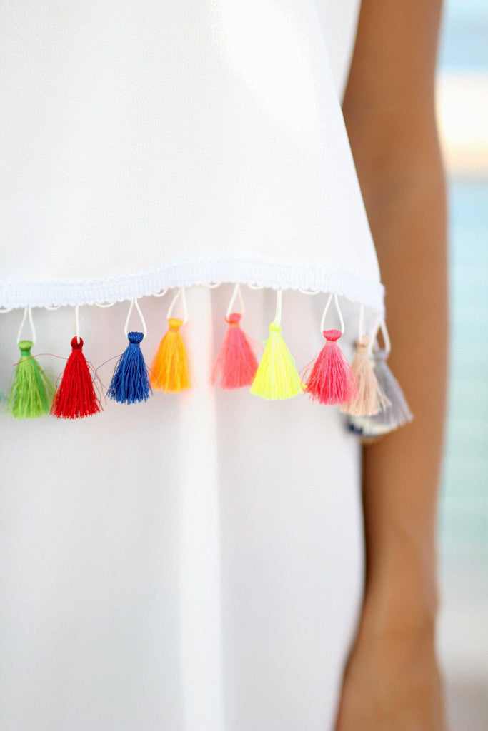 white dress with multi color tassels