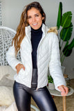 white puff jacket with faux fur hood