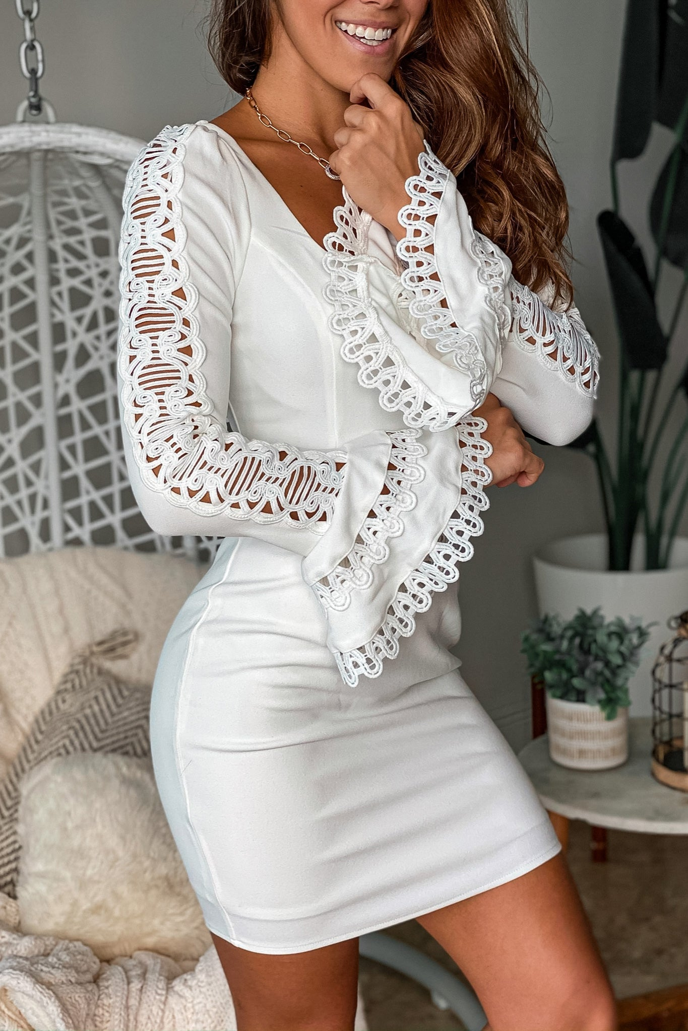 white short dress with crochet long sleeves