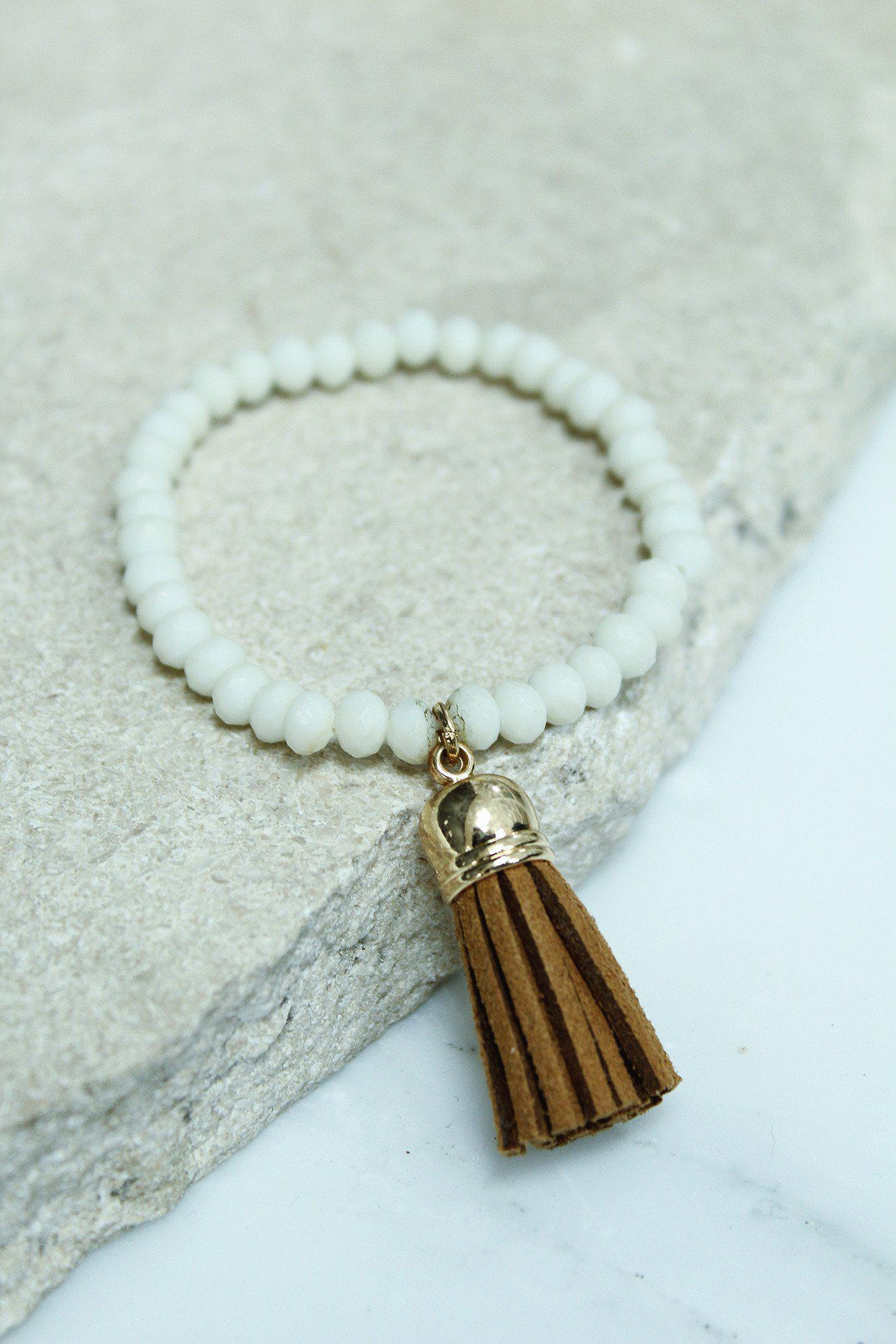 white and brown bracelet