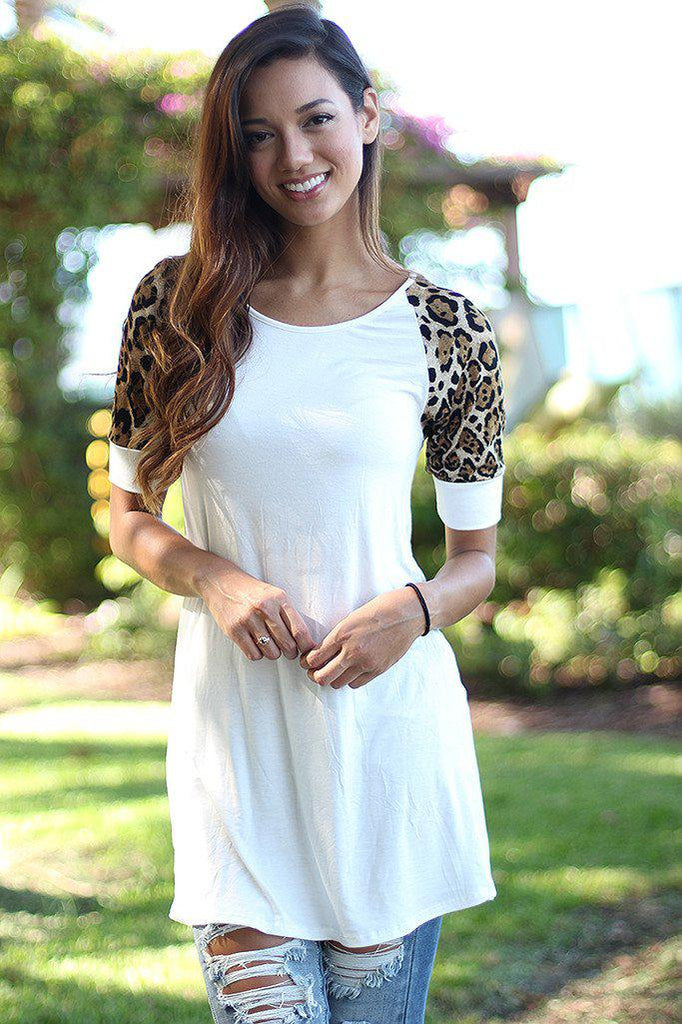 white long top with leopard sleeves
