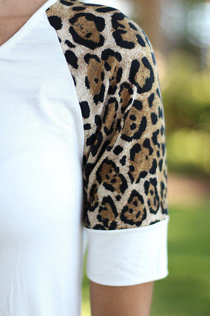 white cute tunic with leopard printed sleeves