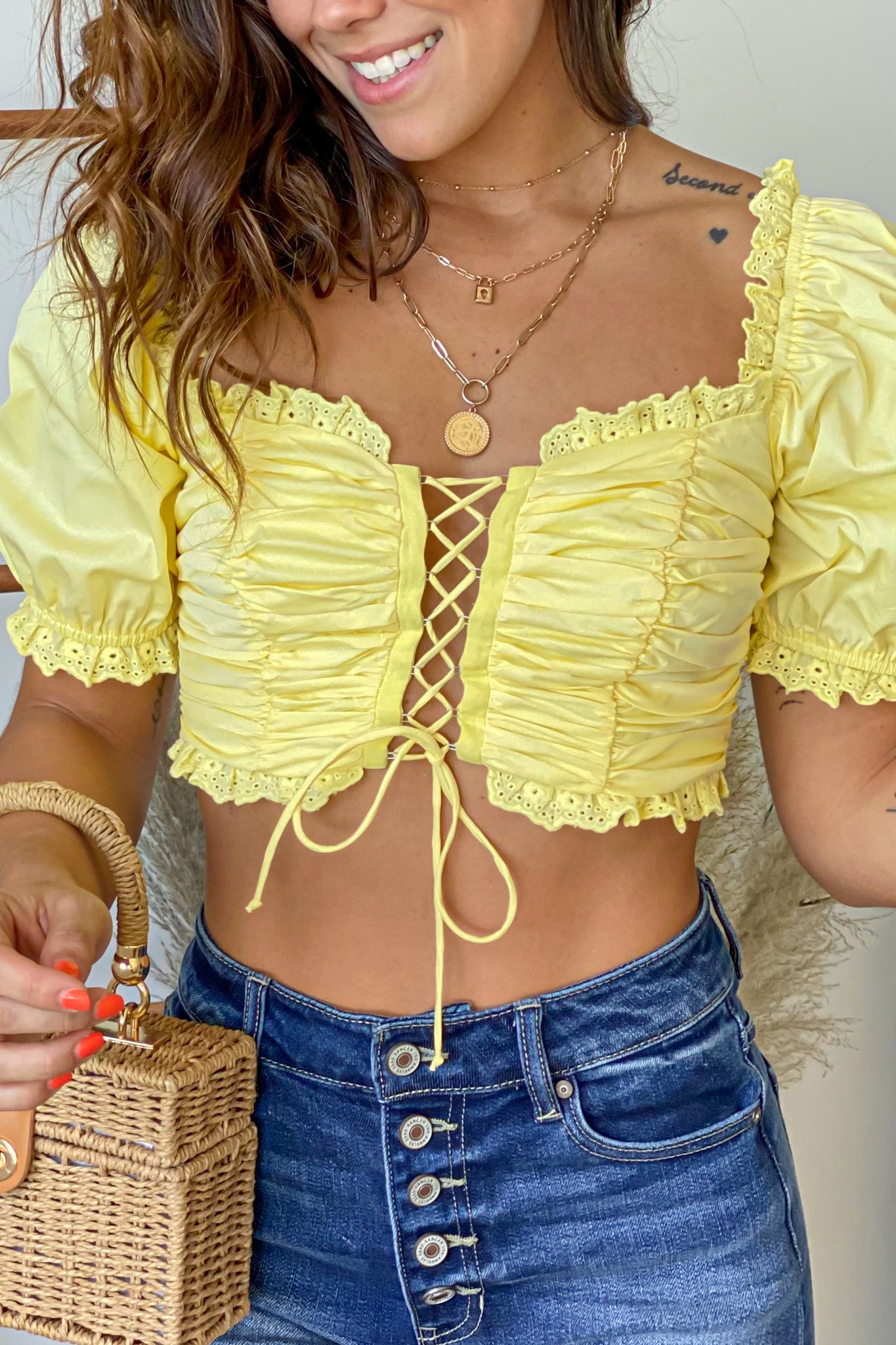 yellow off shoulder crop top with puff sleeves