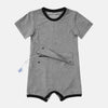 Designed for bigger kids, this charcoal gray adaptive bodysuit has a zipper and snap panel at the abdomen, providing access and protection for feeding tubes, ostomies, and more.