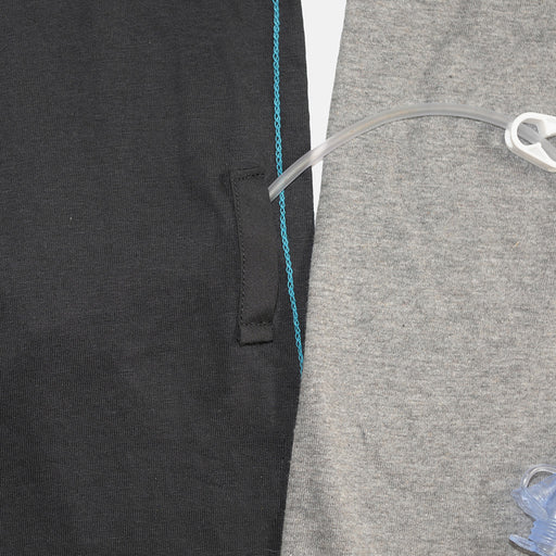 Black and gray baseball tee with adaptive openings along the sides for feeding tube access