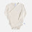 Infant kimono wrap style bodysuit, with adaptive openings in the sides for feeding tube access, in a neutral cream color