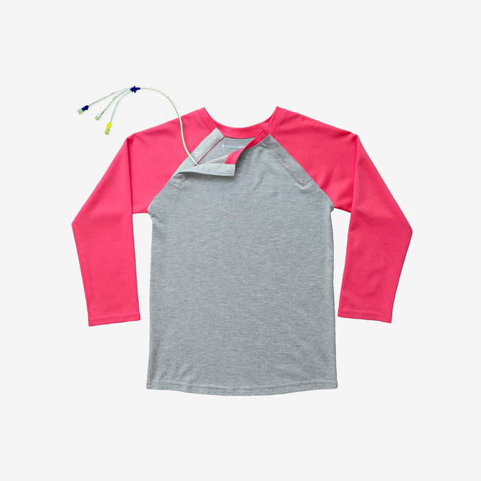 Bright, colorful, and MRI-friendly, this bright pink and heather grey adaptive tee has snaps along the shoulder, making perfect for those with broviacs, chest ports, or chemo treatment!