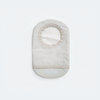 Ivory ostomy bag cover with stoma opening, flap for emptying, and water-resistant fabric