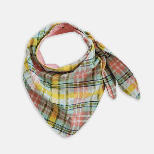 Pink plaid bib made from water-resistant fabric, designed to look like a wrapped scarf