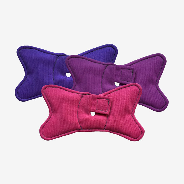 3 pack of trach pads shaped like bowties in pink, purple, and plum colors