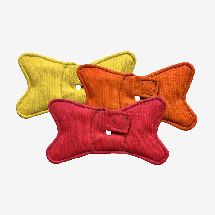 3 pack of tracheostomy pads shaped like bowties in red, orange, and yellow colors