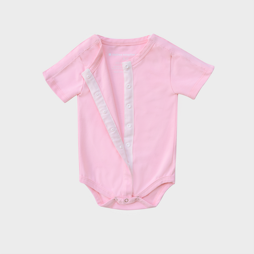 Pale pink adaptive infant bodysuit with snaps across both shoulders and vertically down the front, perfect for babies with low muscle tone, feeding tubes, catheters, or ports