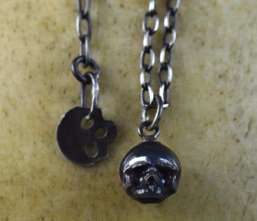 Hand Carved Small Black Pearl Skull with Skull Charm Adjustable Necklace