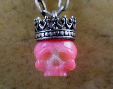 Hand Carved Pink Coral Skull Wearing Sterling Silver Crown Necklace