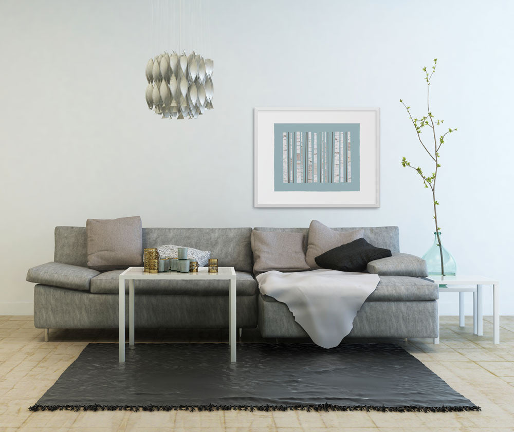 A large print of Grove over a couch in contemporary neutrals.