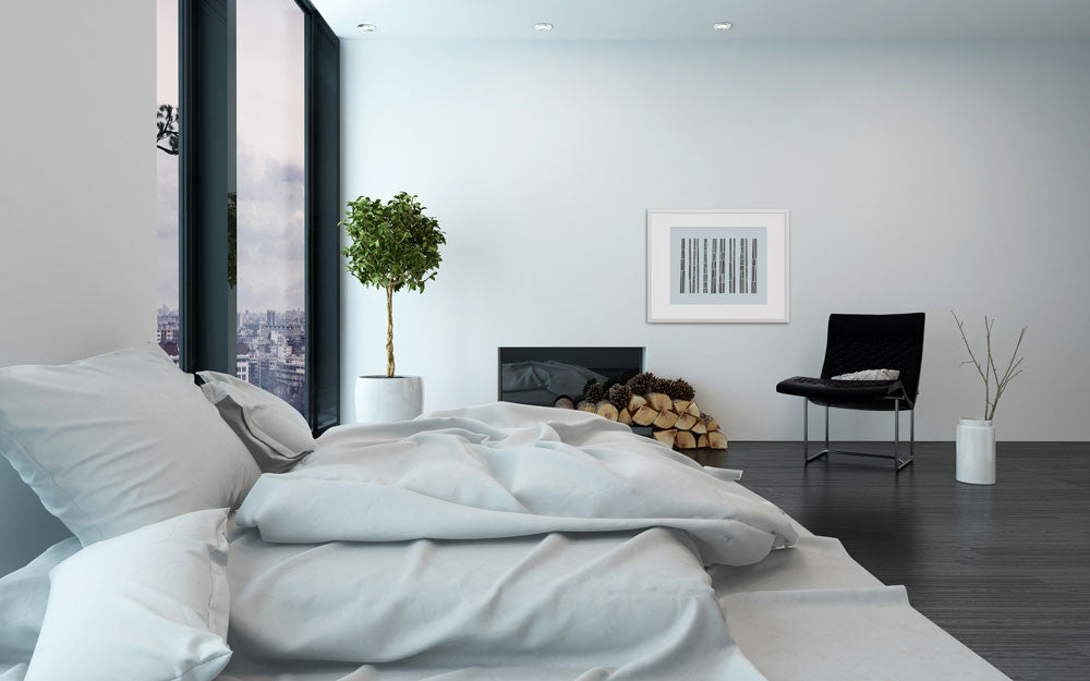 A beautiful minimal bedroom with 'Bark Song Ice' on the wall.
