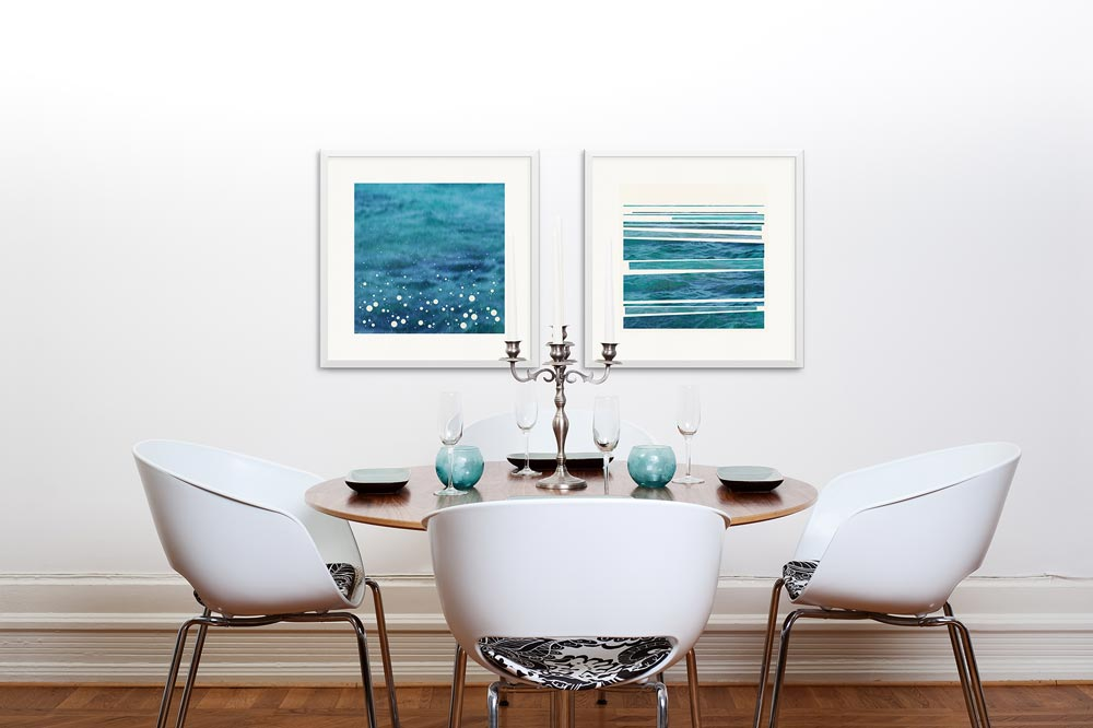 Hanging over a dining room table, 'Syncopated Shore' and 'spray' bring fabulous jewel blue tones.