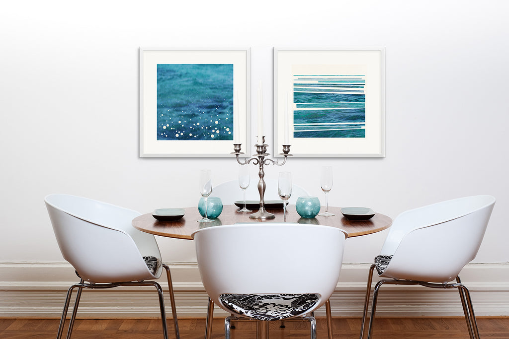 A modern dining room with paired prints of Spray and Syncopated Shore.