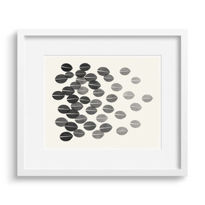 White framed version of a monochrome print with a graphic interpretation dried leaves.