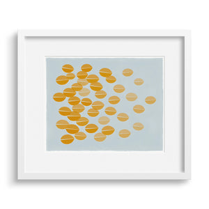 White framed version of a graphic print of ochre leaves rustling in the breeze.