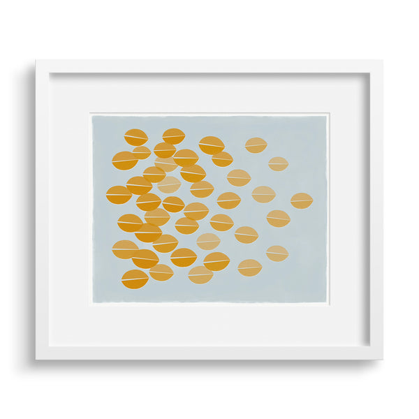 White framed version of a graphic print of ochre leaves rustling in the breeze by Janet Taylor | Household Art.