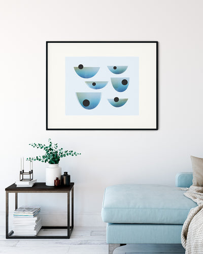 Black framed image of Drift Print by Janet Taylor | Household Art, on the wall in a light living room.