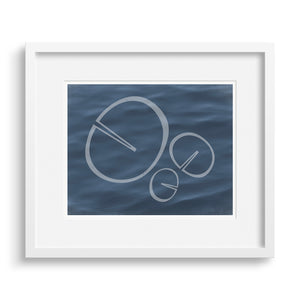 "White framed version of fine art print ""Memory"", based on the shape of a water lily leaf. Limited Edition Archival Print."