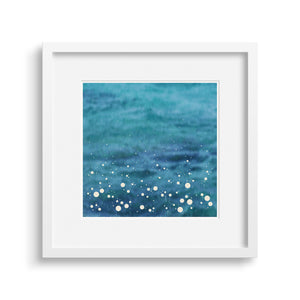 White framed version of a modern print Inspired by the spray shown up by the sea as it crashes into the shore