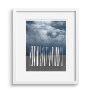 White framed version of a limited edition art print of a silhouette of stylized trees against the sky.