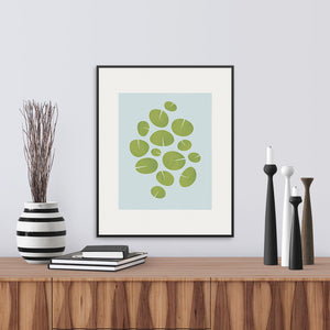 A limited edition print of waterlilies in light blue and green. Archival Graphic Print.