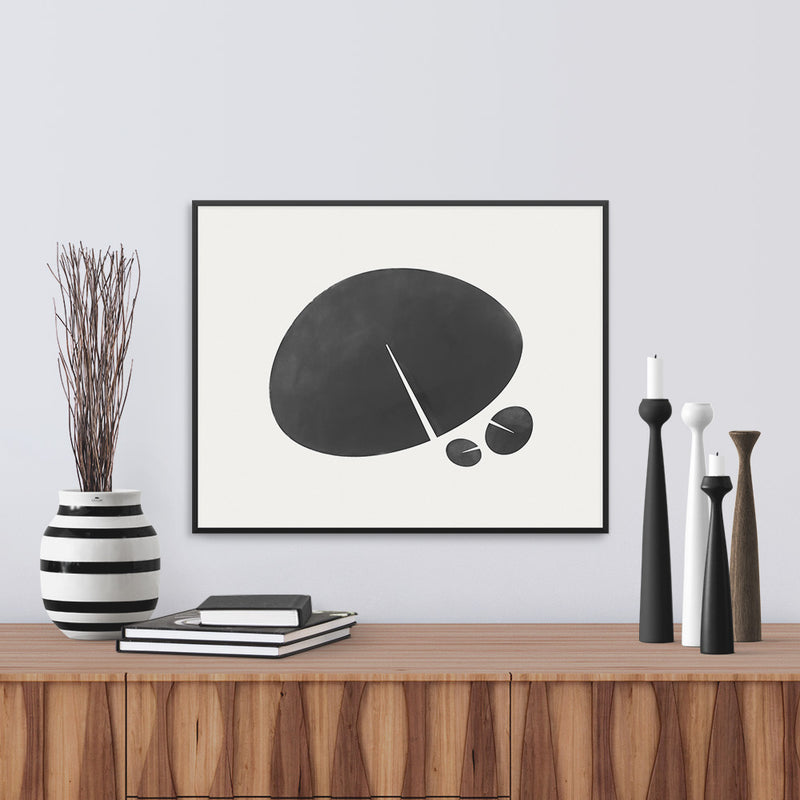 Framed view of a black and white print based on the shape of a lily leaf. Limited Edition Archival print by Janet Taylor | Household Art.