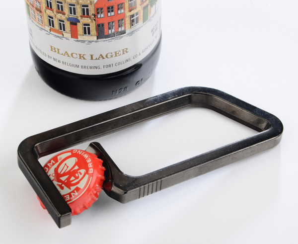 Magnetic Bottle Opener with cap grabbed