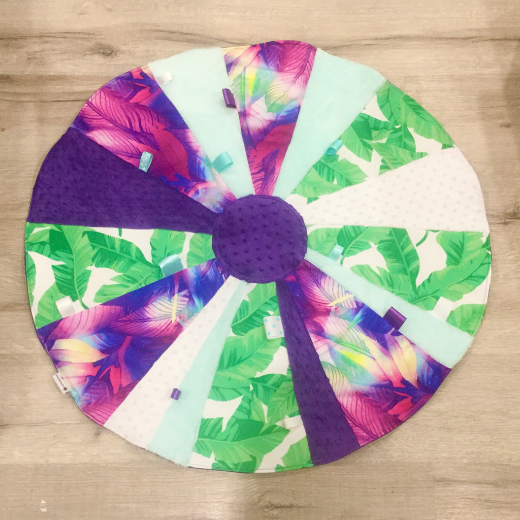 Mucky duck crafts circular sensory play mat in pink and green leaves