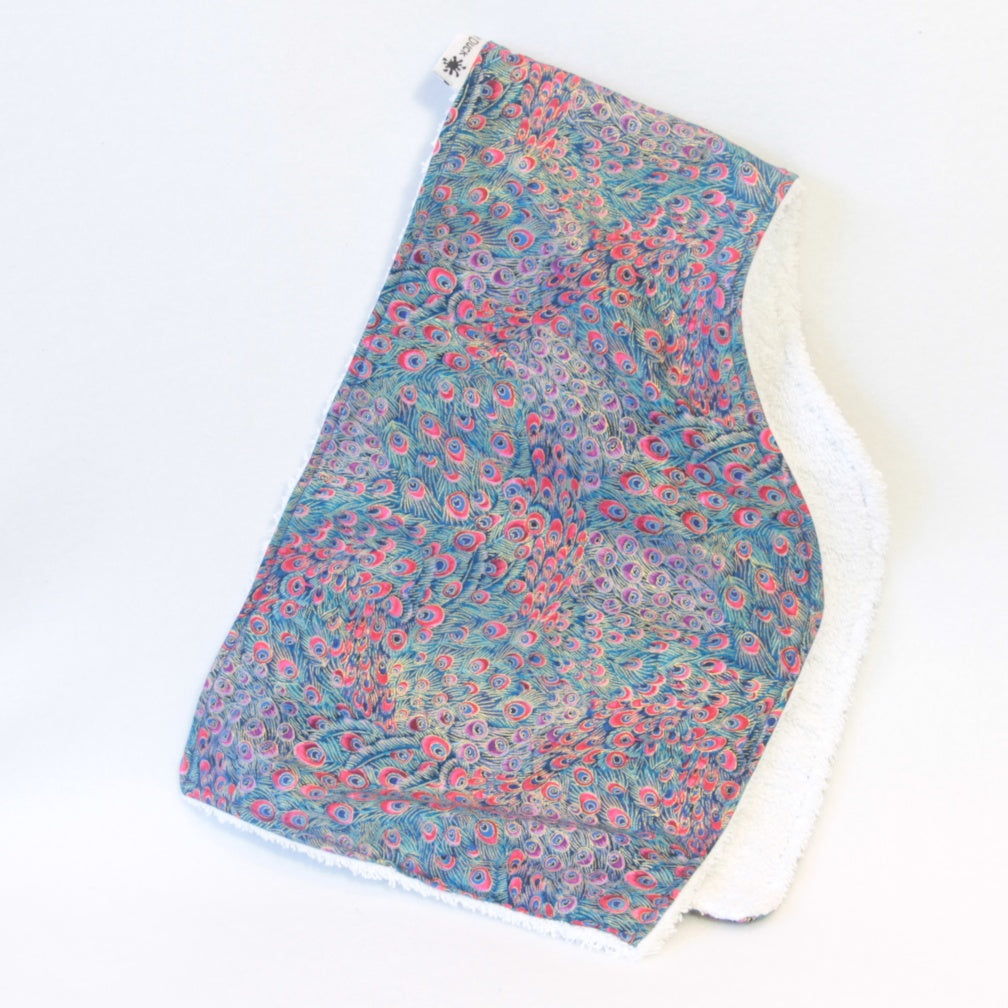 Mucky Duck Crafts Pink Purple blue and green contoured peacock pattern burp cloth